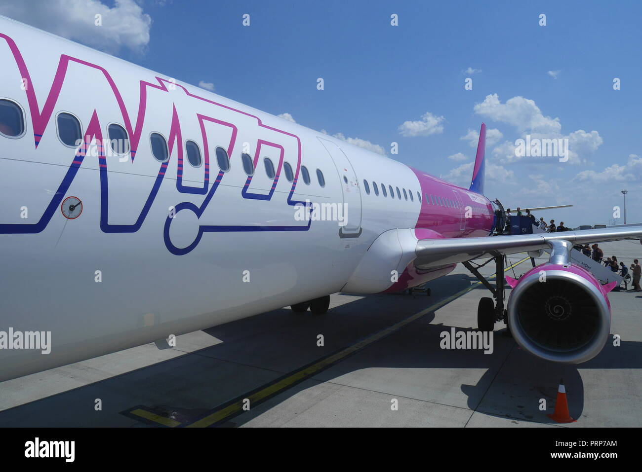 Wizz Air Airbus A320 200 boarding at Budapest Ferihegy Airport, Budapest, Hungary - Stock Image