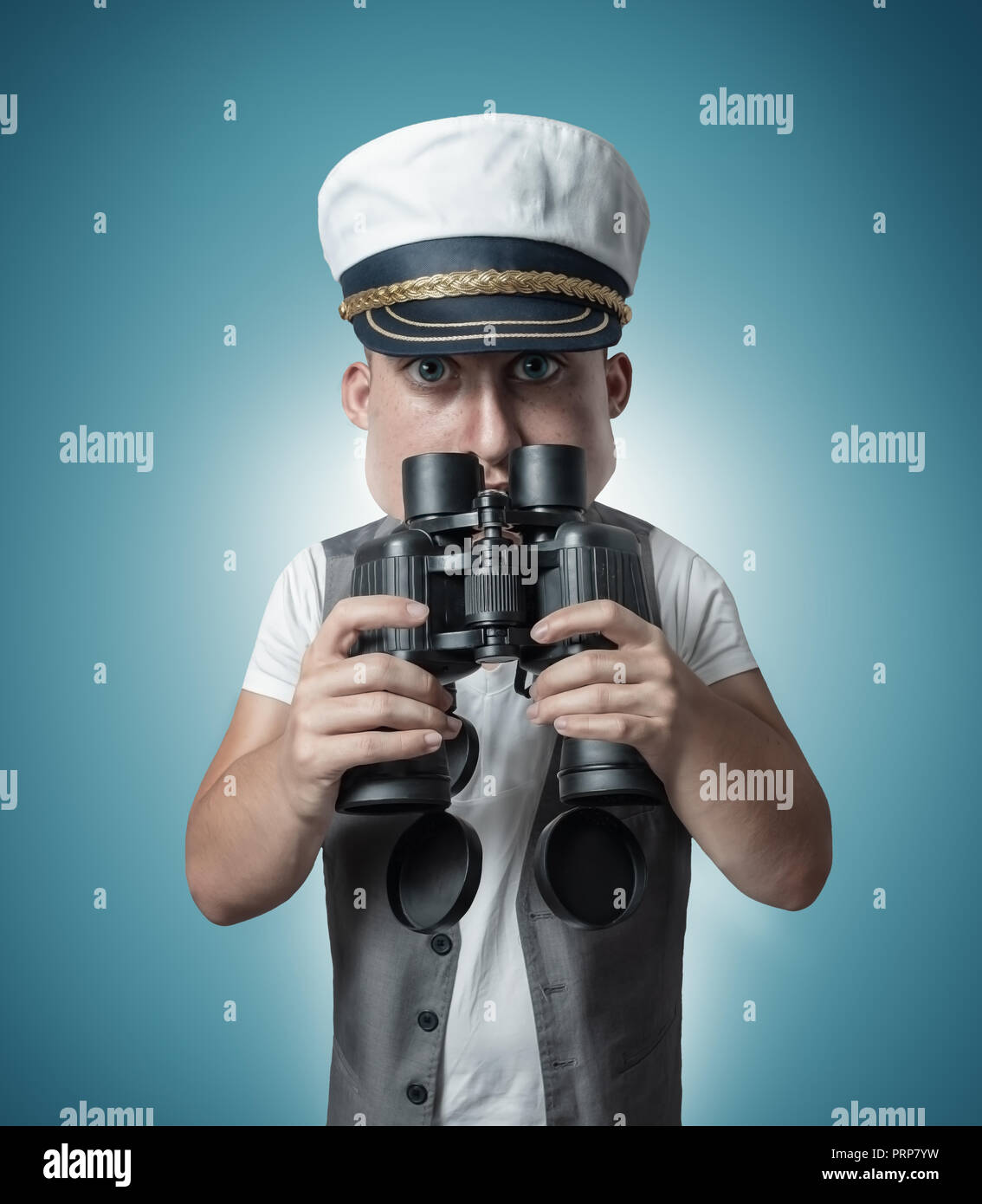 caricature of funny sailor captain holding binoculars and watching - Stock Image