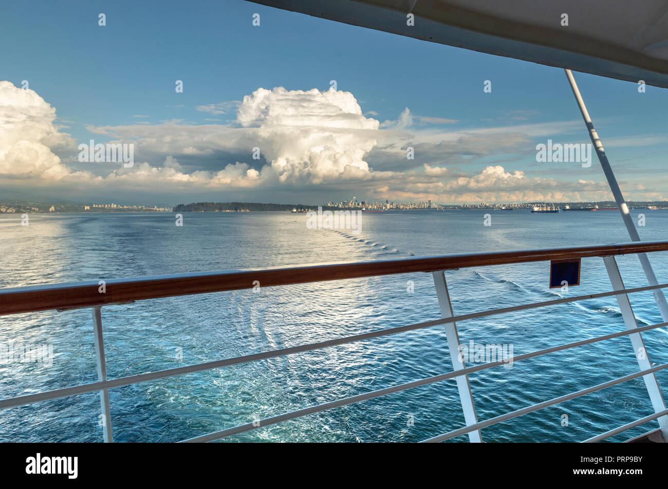 View of English Bay Stanley Park and Burrard Inlet, Vancouver, British Columbia, Canada from rear deck of cruise ship on a clear sunny day. - Stock Image