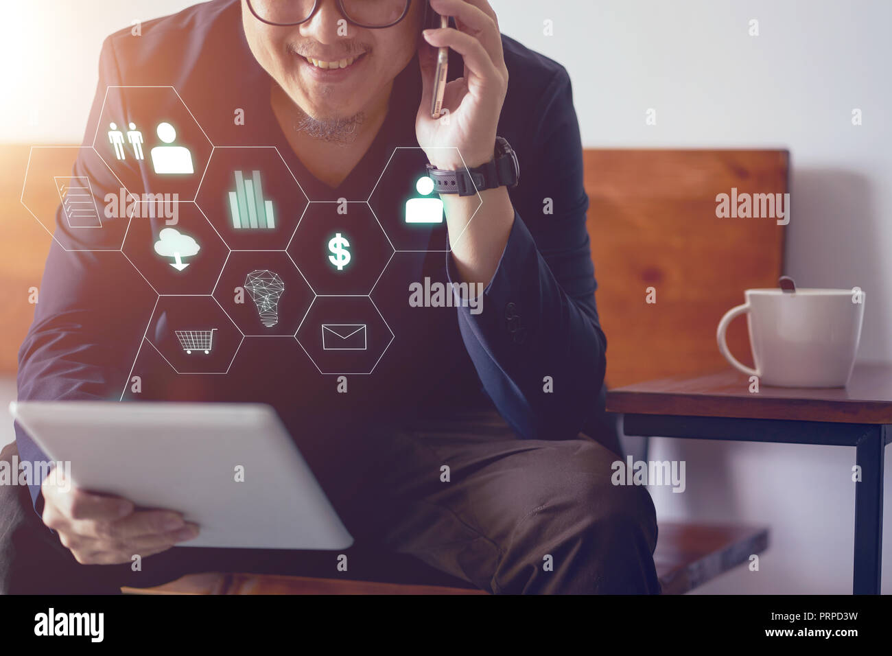 Man holding digital tablet making online shopping and banking payment. Blurred background . - Stock Image