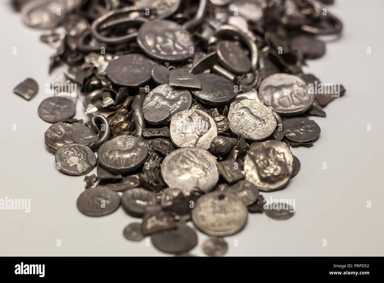 Malaga, Spain - Sept 21th, 2018: Hoard of Cerro Colorado, oldest coins ever made in iberia. Malaga Museum, Spain - Stock Image