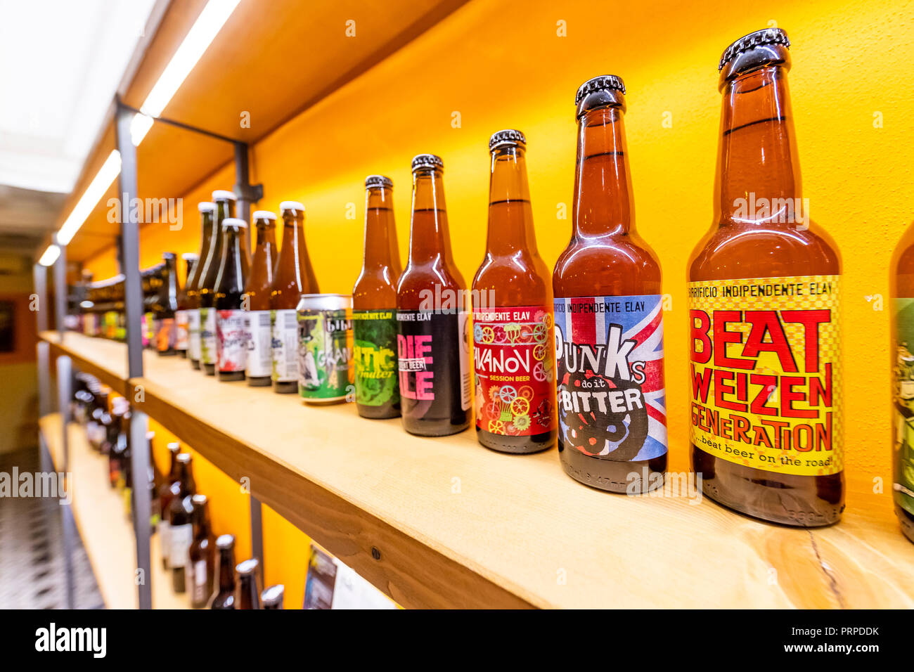 The artisan craft beer movement is strong in Italy. Her in Lucca is artigianale beer selling many varieties. Lucca city, Italy - Stock Image