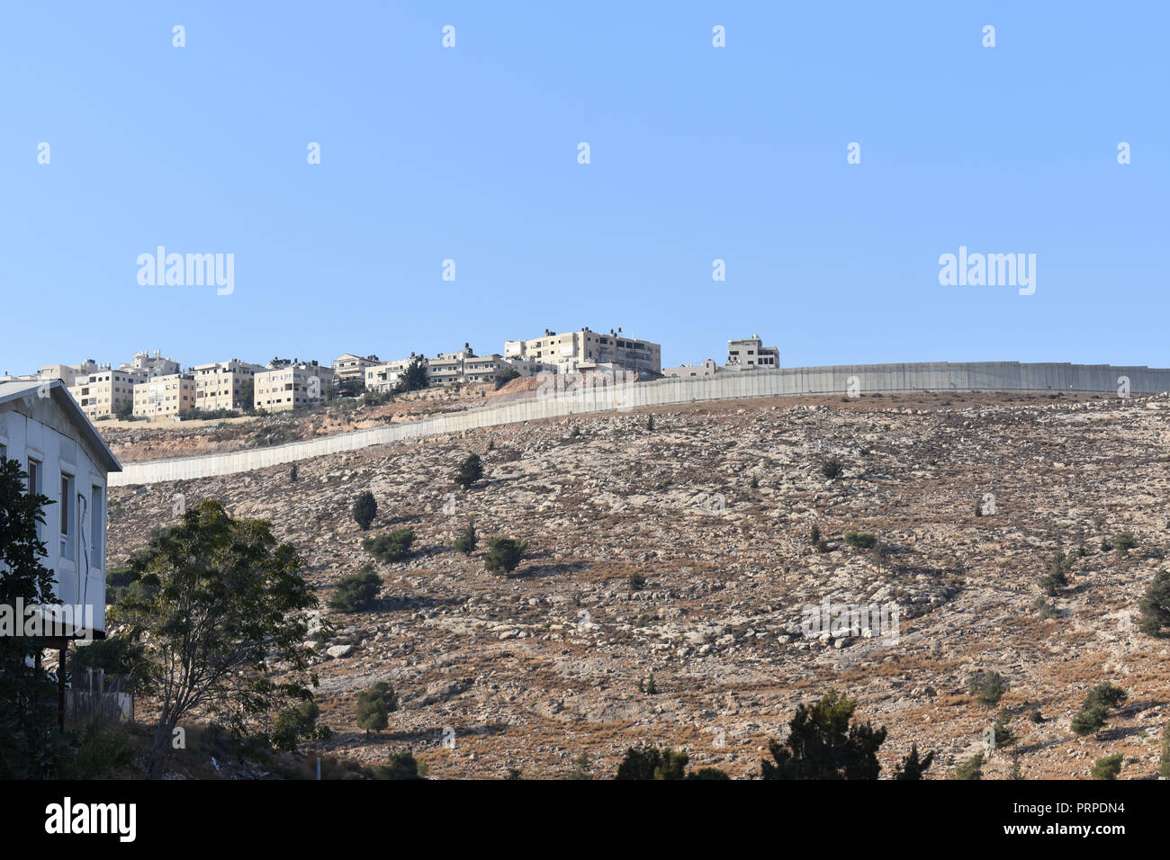 Ramallah as seen from behind security barrier - Stock Image