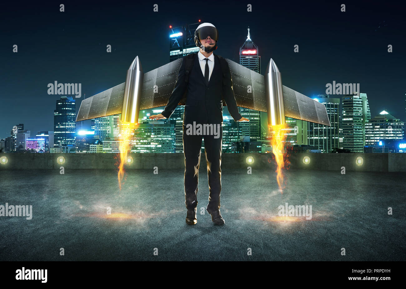 Businessman wear a rocket suit to lift , Business start up success concept . Modern city background . - Stock Image