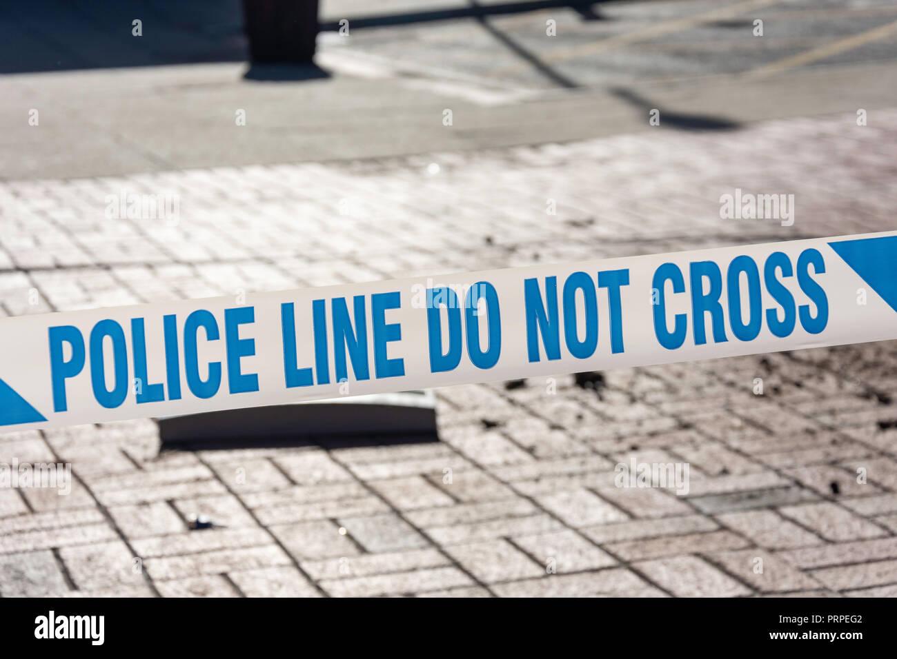'Police line do not cross' tape, Reading, Berkshire, England, United Kingdom - Stock Image