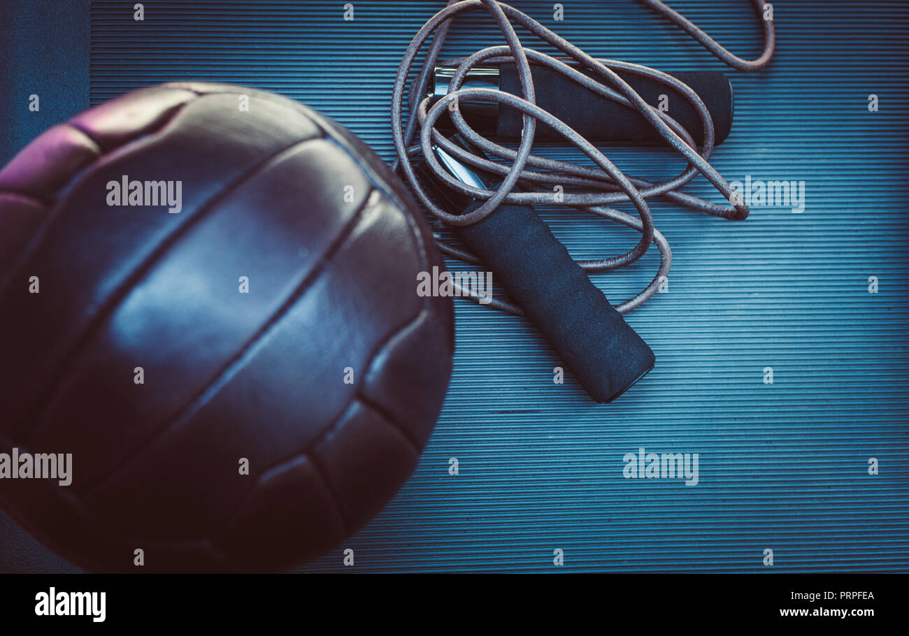 closeup photo of a skipping rope and a soccer ball Stock Photo