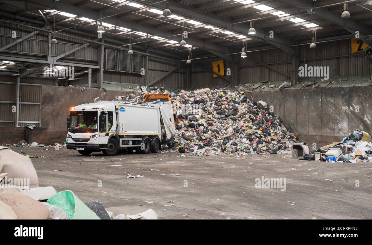 Dennis refuse truck emptying domestic waste in the Campground waste and recycling centre, Wrekenton, Gateshead, England, UK - Stock Image