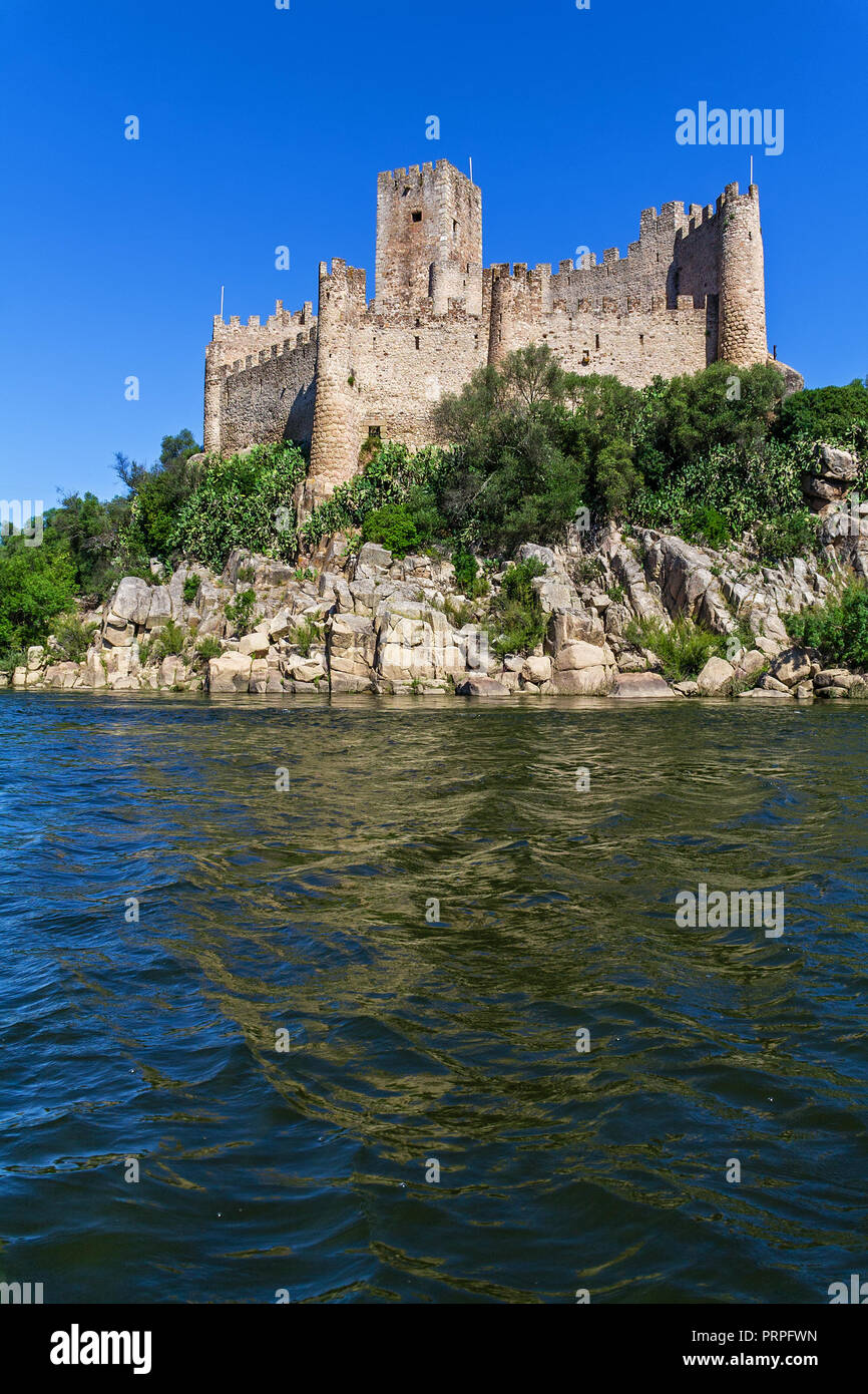 Castle of Almourol, an iconic Knights Templar fortress built on a rocky island in the middle of Tagus river. Almourol, Portugal - Stock Image
