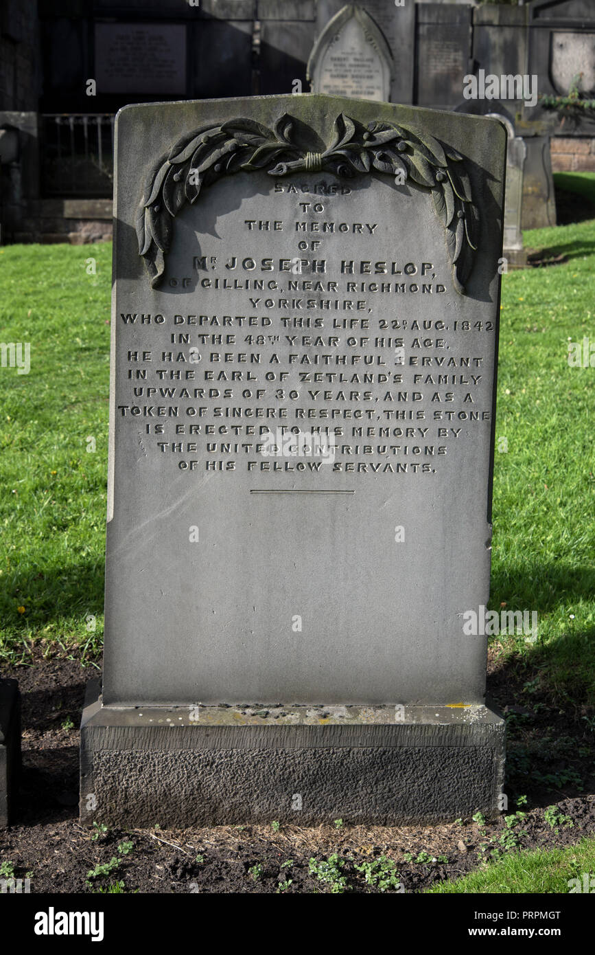 Joseph Heslop's headstone, a faithful servant in the Earl of Zetland's family, headstone erected by the united contributions of his fellow servants. - Stock Image