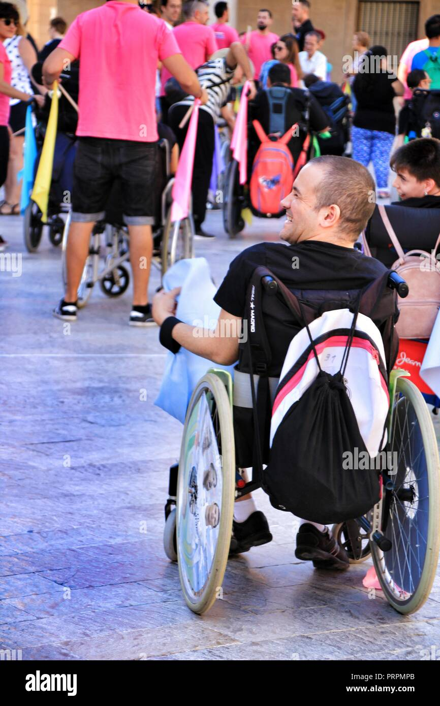 Elche, Alicante, Spain- October 3, 2018: People participating and having fun with activities in Elche city celebrating the world day of cerebral palsy - Stock Image