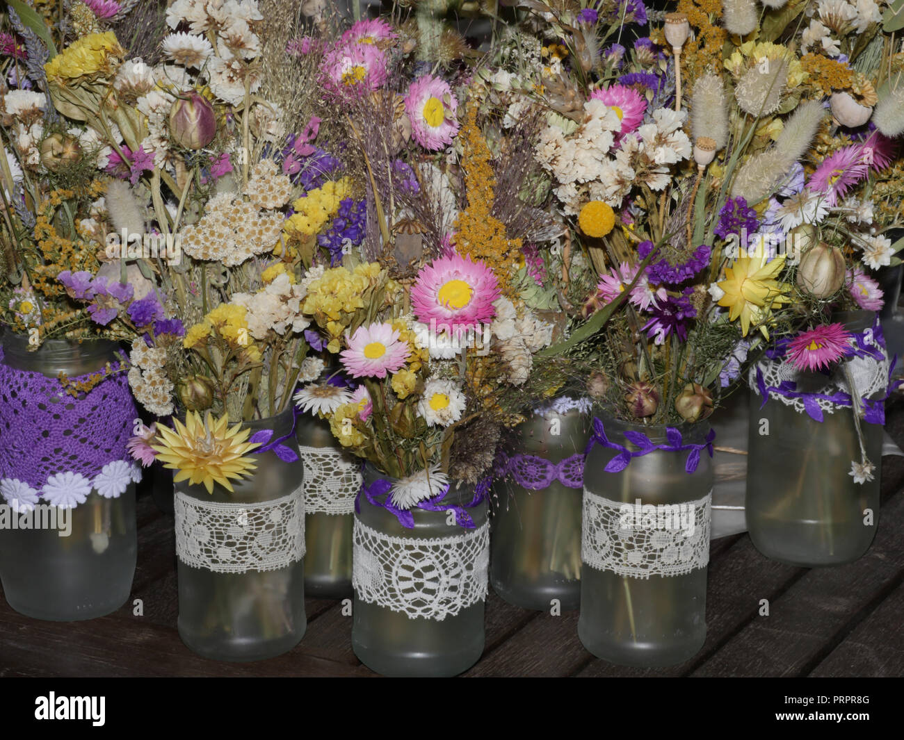 Dried Flowers In Jam Jars For Wedding Tables Stock Photo Alamy