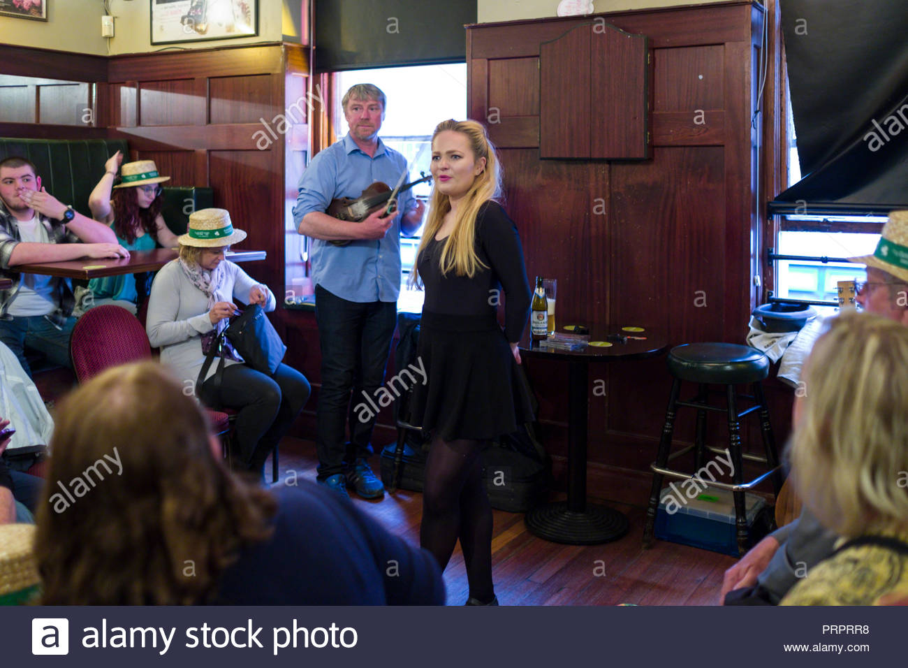 Young woman demonstrating traditional Irish dance during the musical pub crawl tour, North City, Dublin, Leinster, Ireland - Stock Image