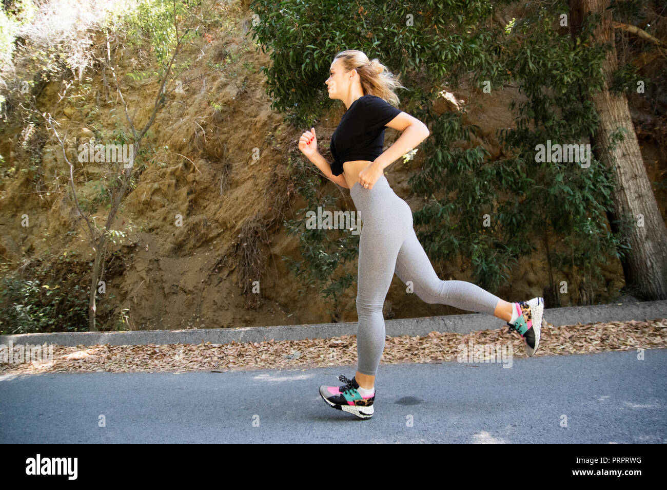 Young woman outdoor running - Stock Image