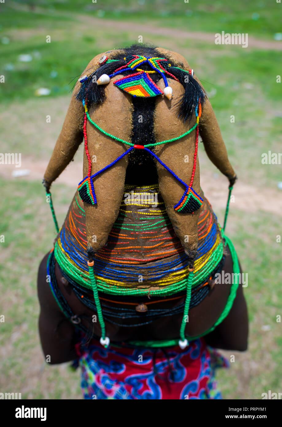 Rear view of a Mumuhuila tribe woman, Huila Province, Chibia, Angola Stock Photo