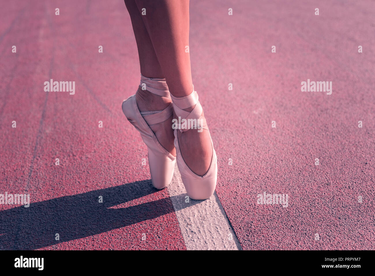 Close up of ballerines feet in pointe shoes - Stock Image