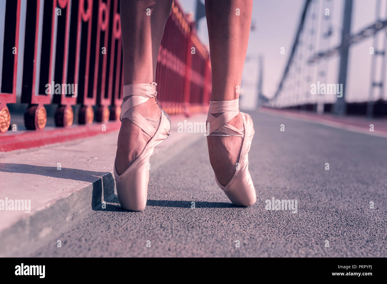 Close up of pointe shoes being worn by ballerina - Stock Image