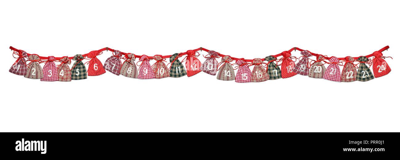 Adventskalender Socken an Weihnachten vor weissem Grund - Stock Image