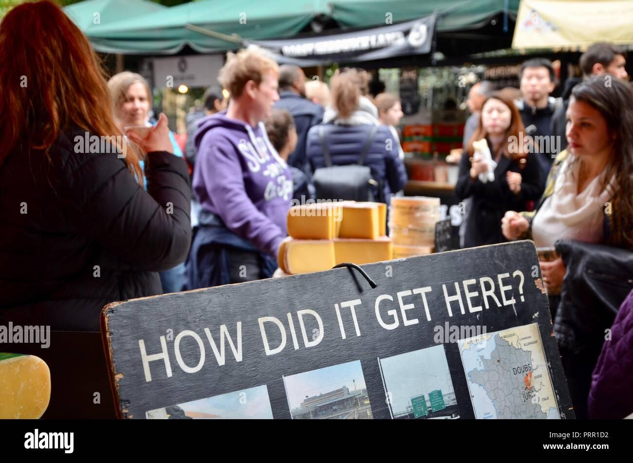 Cheese stall with sign showing provenance, Borough Market, Southwark, London, England, UK. - Stock Image