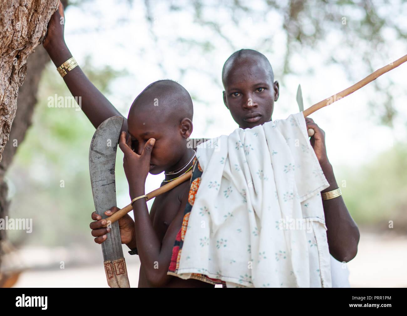 Mucubal tribe young men, Namibe Province, Virei, Angola Stock Photo