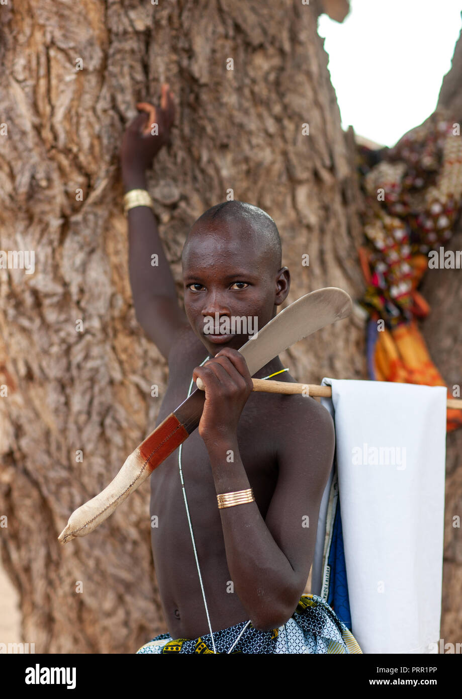 Portrait of a Mucubal tribe man with his machete, Namibe Province, Virei, Angola Stock Photo