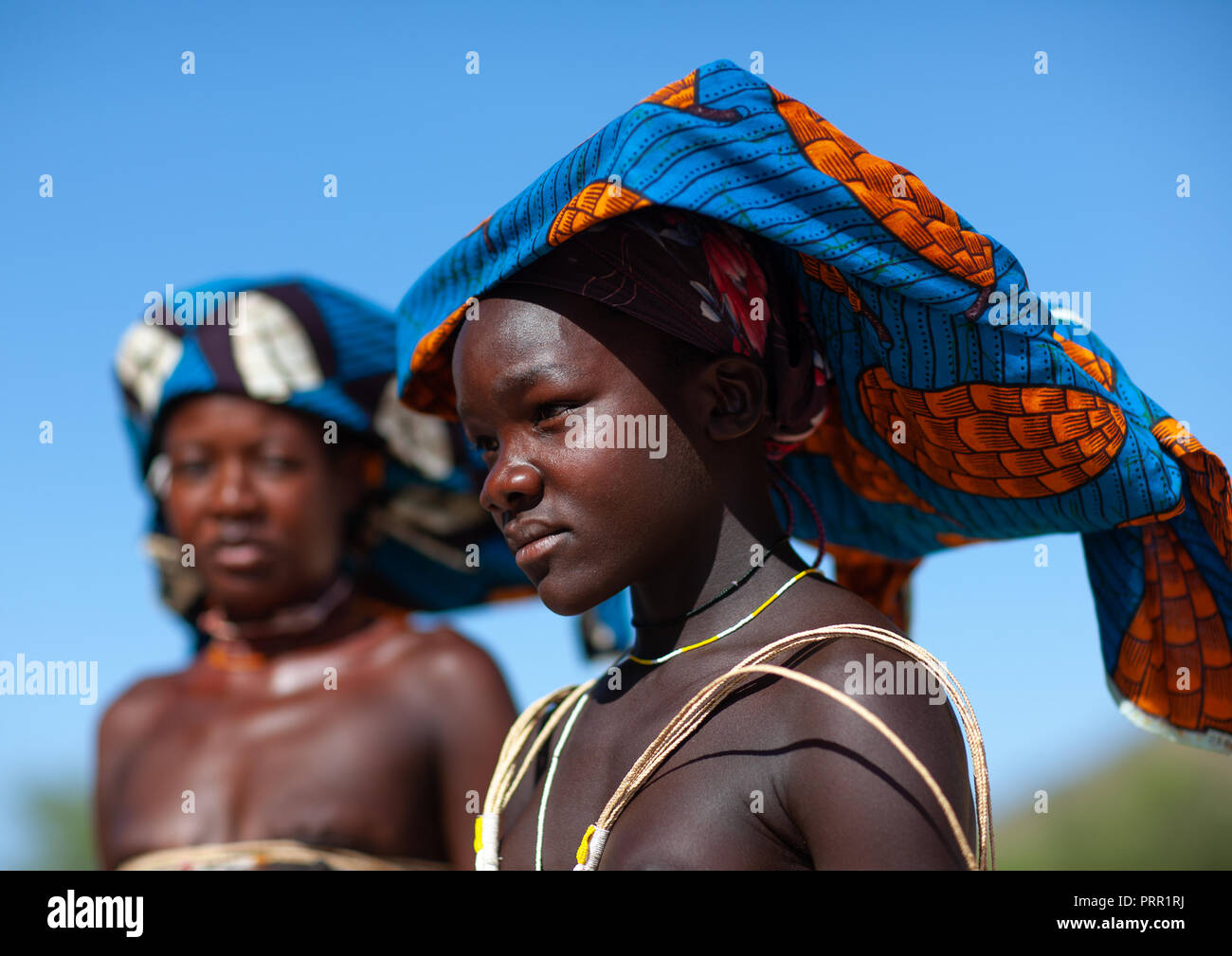Portrait of a Mucubal tribe women wearing colorful headwears, Namibe Province, Virei, Angola Stock Photo
