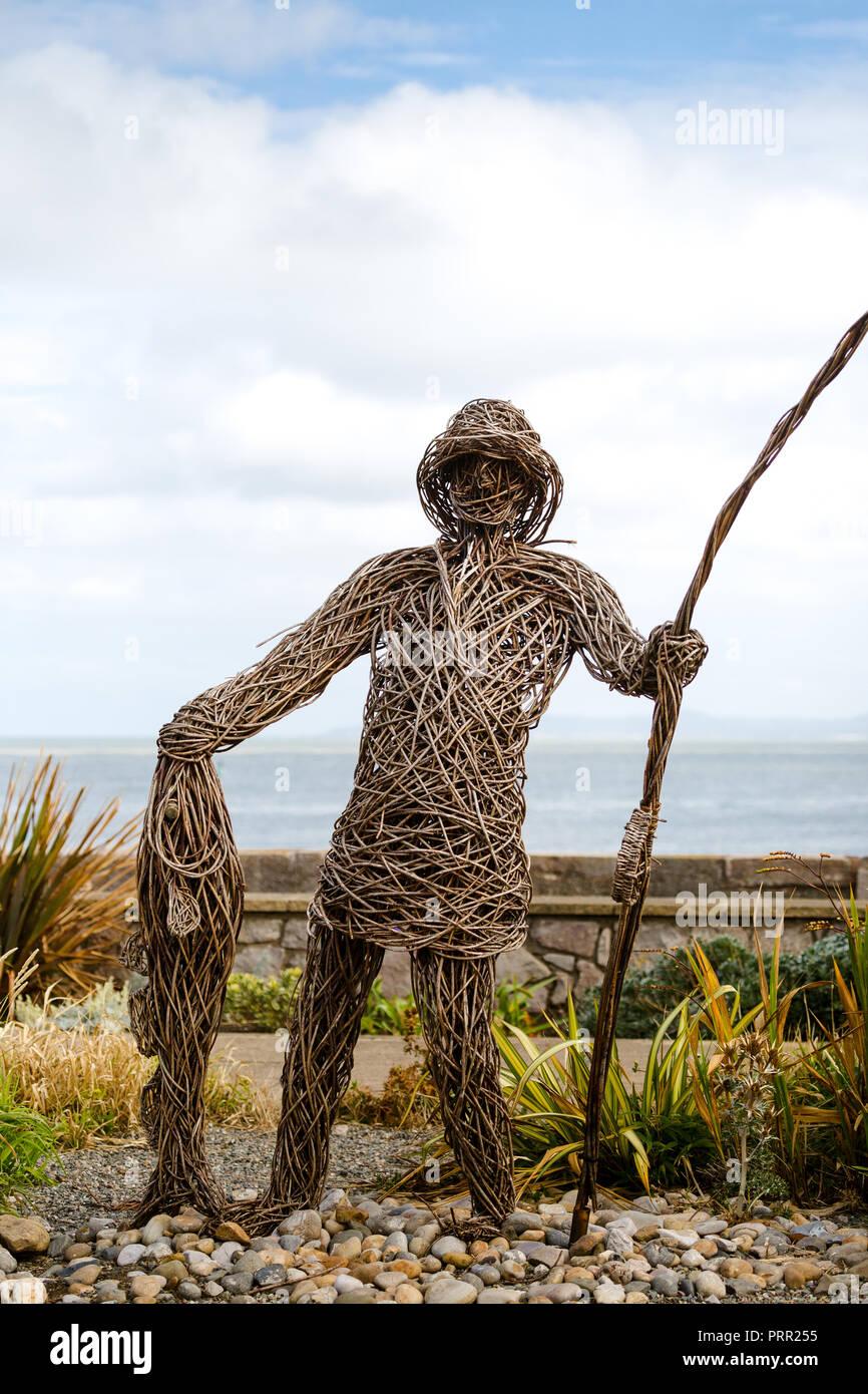 Rhos on Sea Wales UK. Willow Fisherman on Promenade. - Stock Image