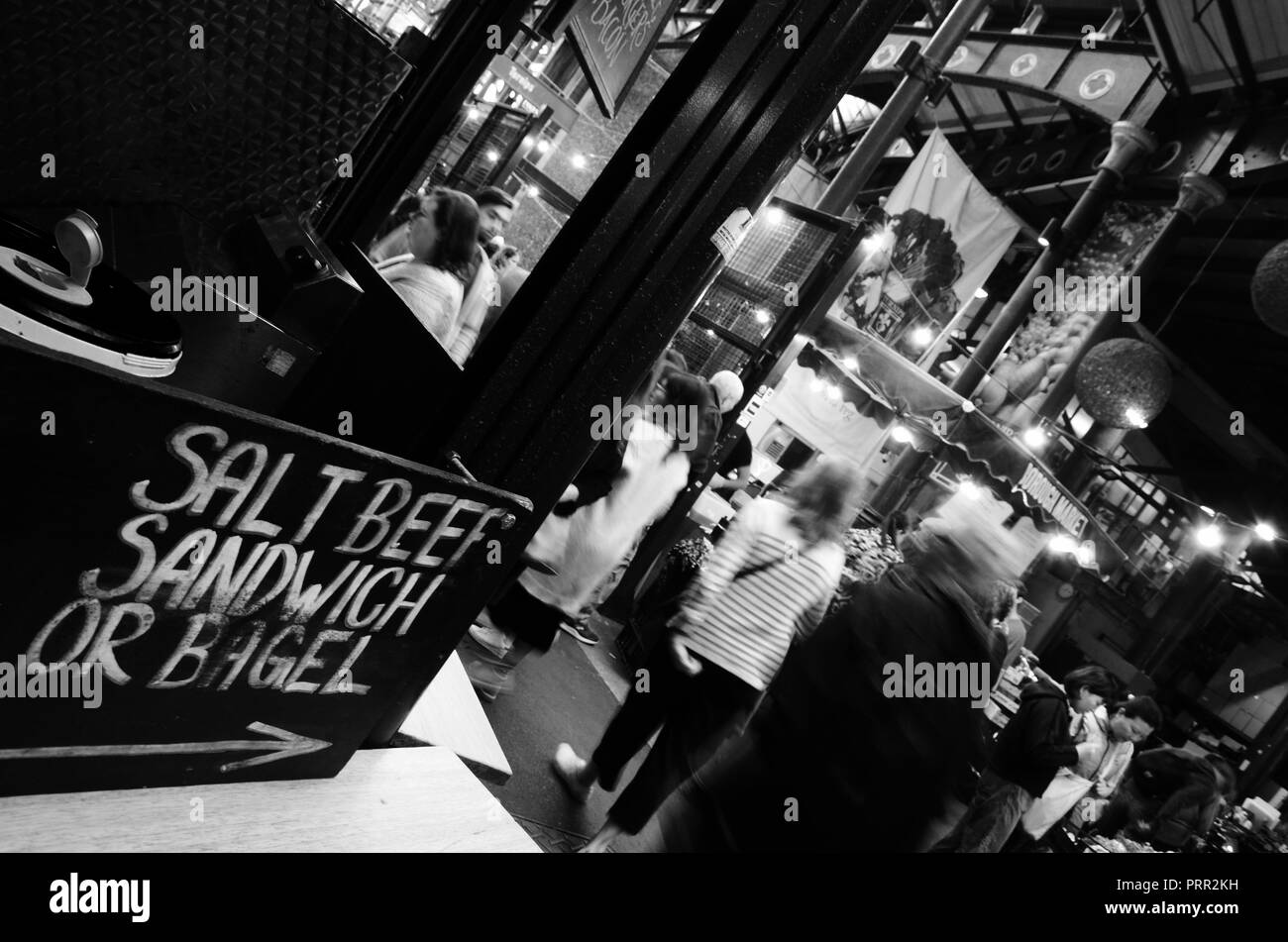 Black and white photograph. Salt beef sandwich and bagel sign, Borough Market, Southwark, London, England, UK. - Stock Image