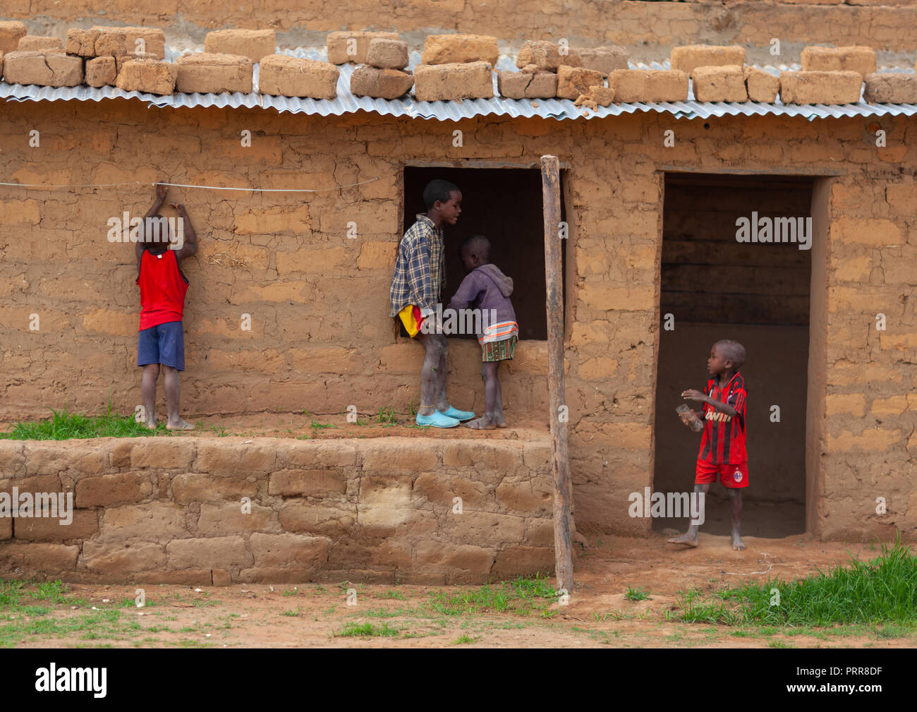 Angolan children playing in front of a house, Huila Province, Caconda, Angola Stock Photo