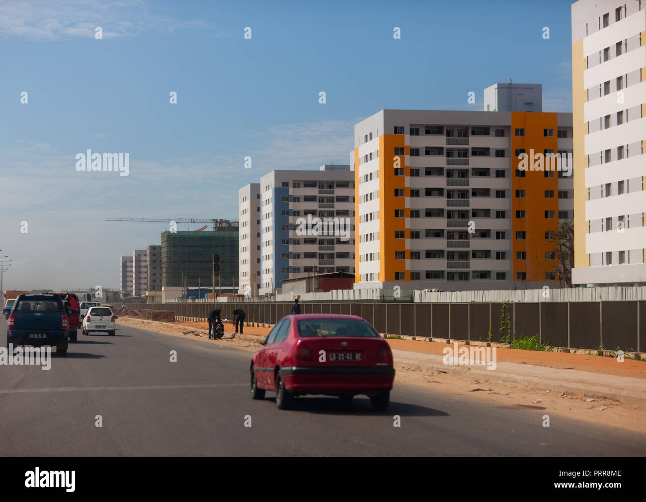 Car on a highway along brand new buildings, Luanda Province, Luanda, Angola - Stock Image
