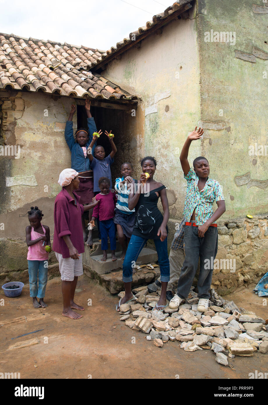 Angolan boys and girls in a village with mangoes, Huila Province, Caconda, Angola Stock Photo