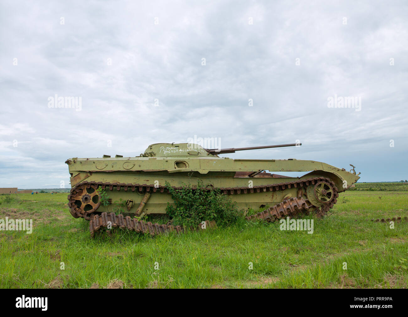 Tank wreck from the civil war in a field, Huila Province, Caconda, Angola Stock Photo