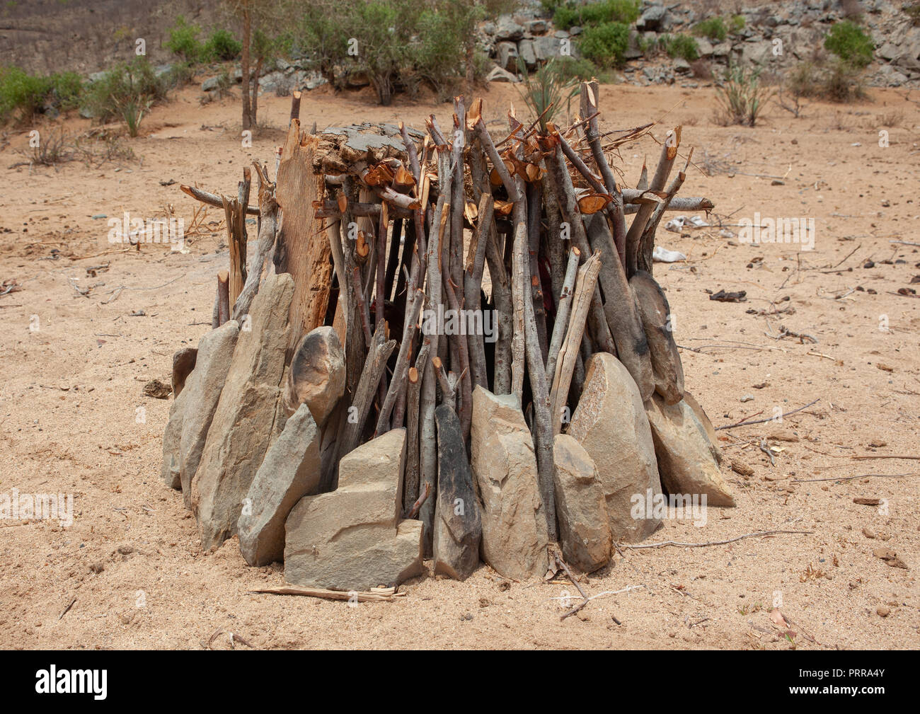 Shelter made with wood and stones to protect the chickens, Namibe Province, Virei, Angola - Stock Image