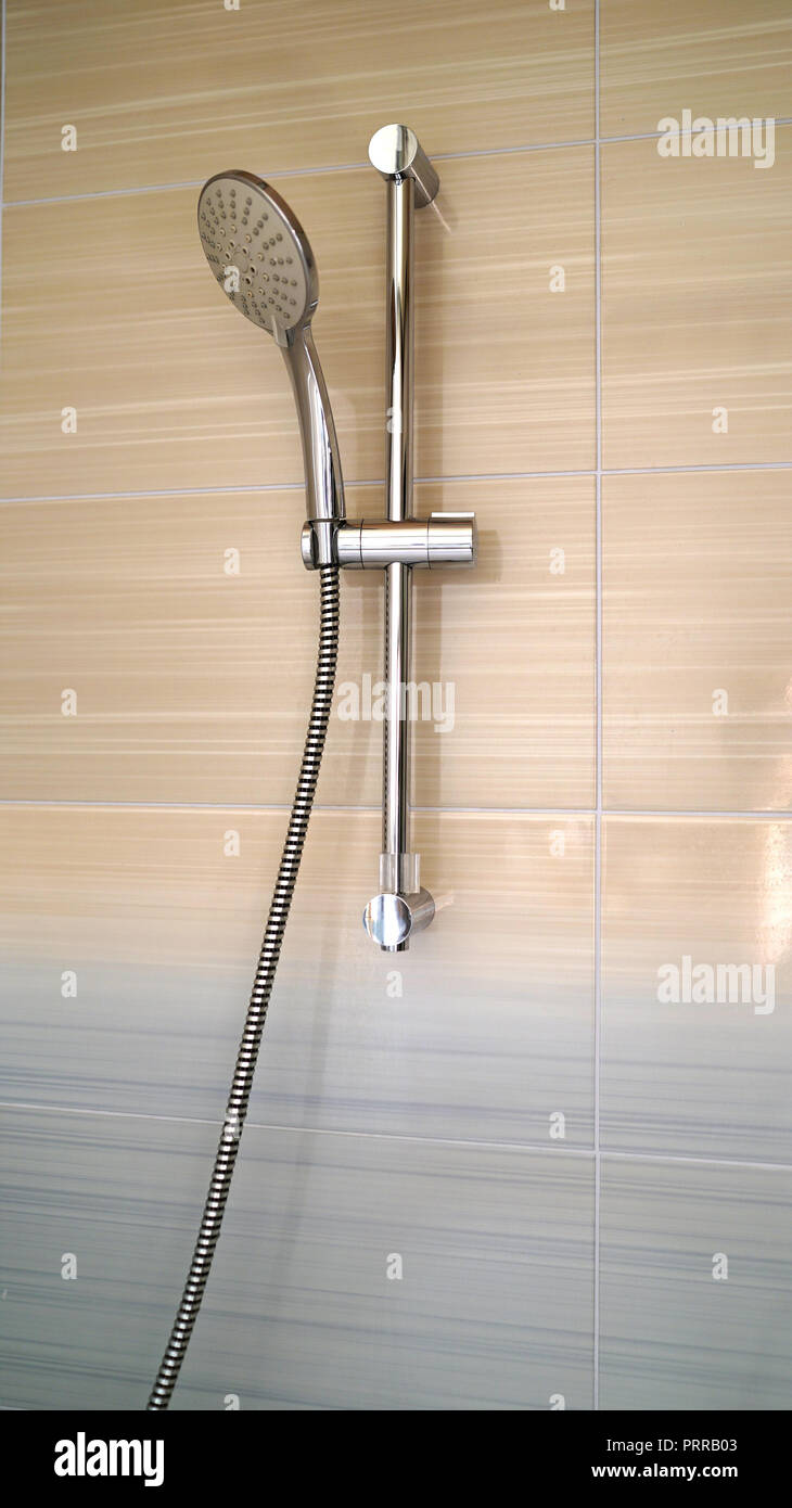 shower and shower holder. modern chrome shower attachment with thermostatic controller Stock Photo