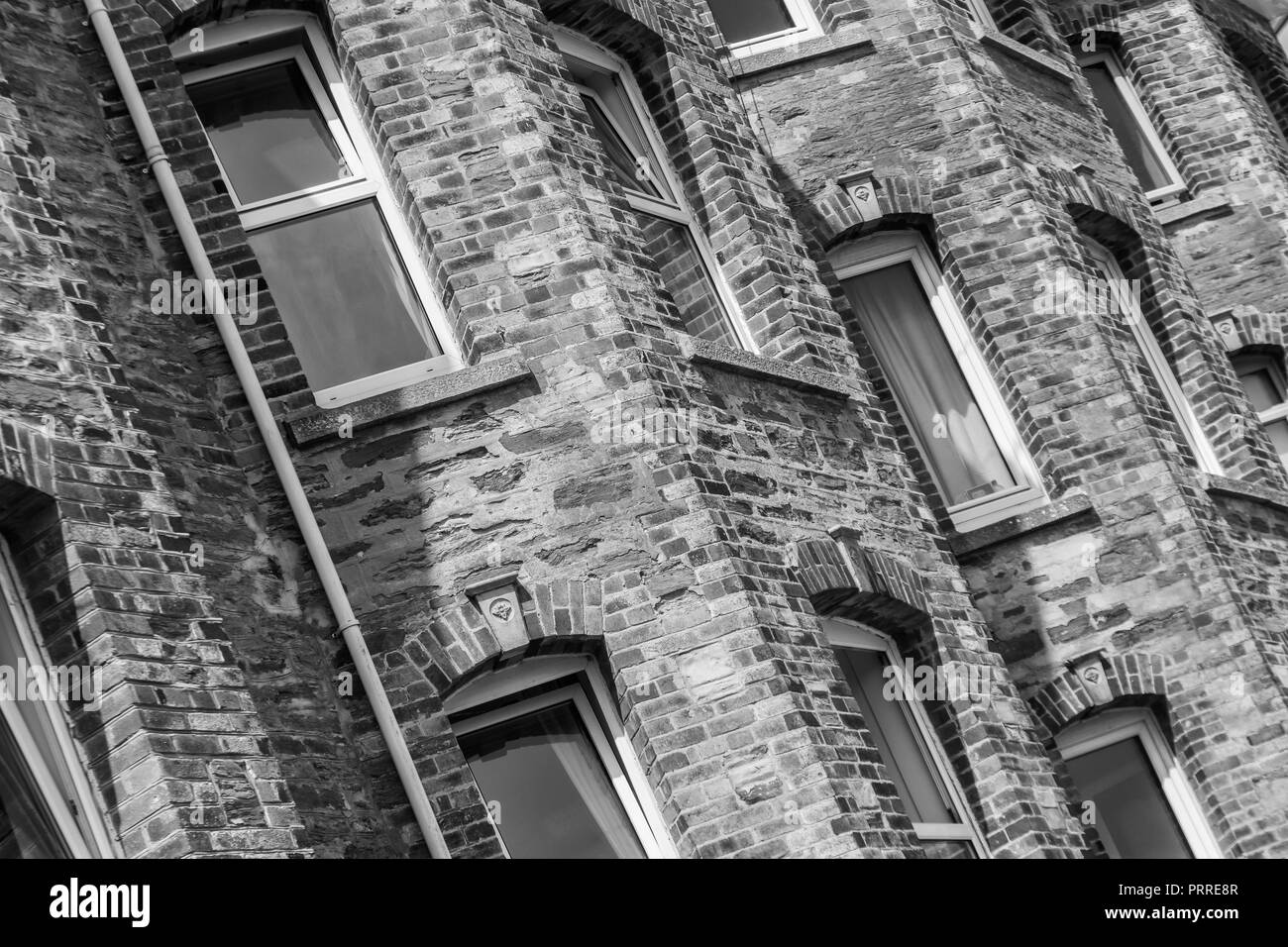 Rear part of block of flats in Newquay, Cornwall. Metaphor for 'generation rent', and getting on the housing ladder, rent concept. Stock Photo