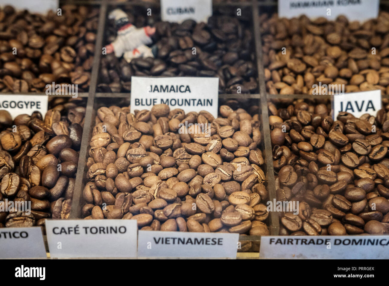 UK,London,Soho,Algerian coffee company-  Jamaica Bluen Montain and other variety of coffee beans on display-selective focus - Stock Image