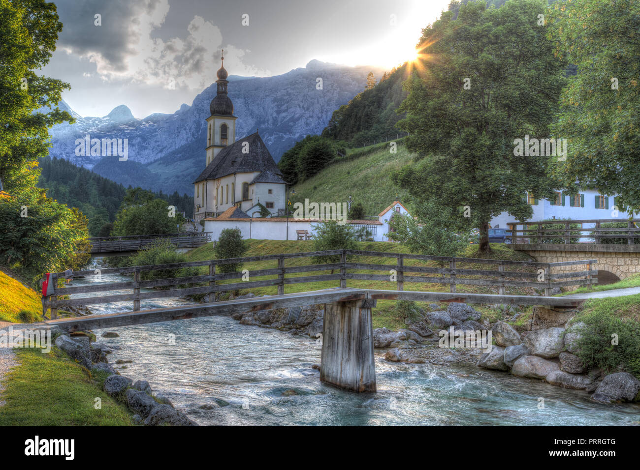 Parish church St. Sebastian with Ramsauer Ache, Ramsau, Berchtesgaden area, Bavaria, Germany - Stock Image