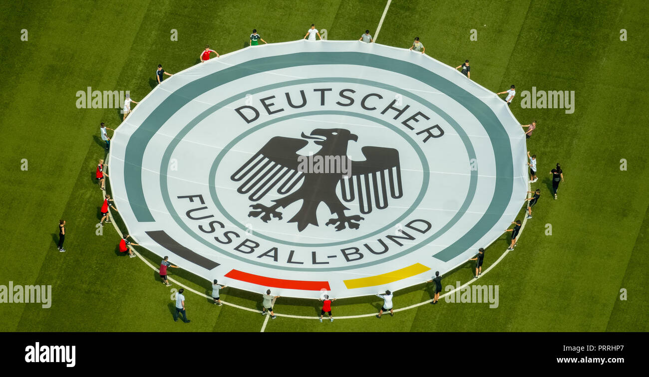 Young football players with rolled out banner with emblem German Football Association, Stadion Niederrhein, Oberhausen Stock Photo