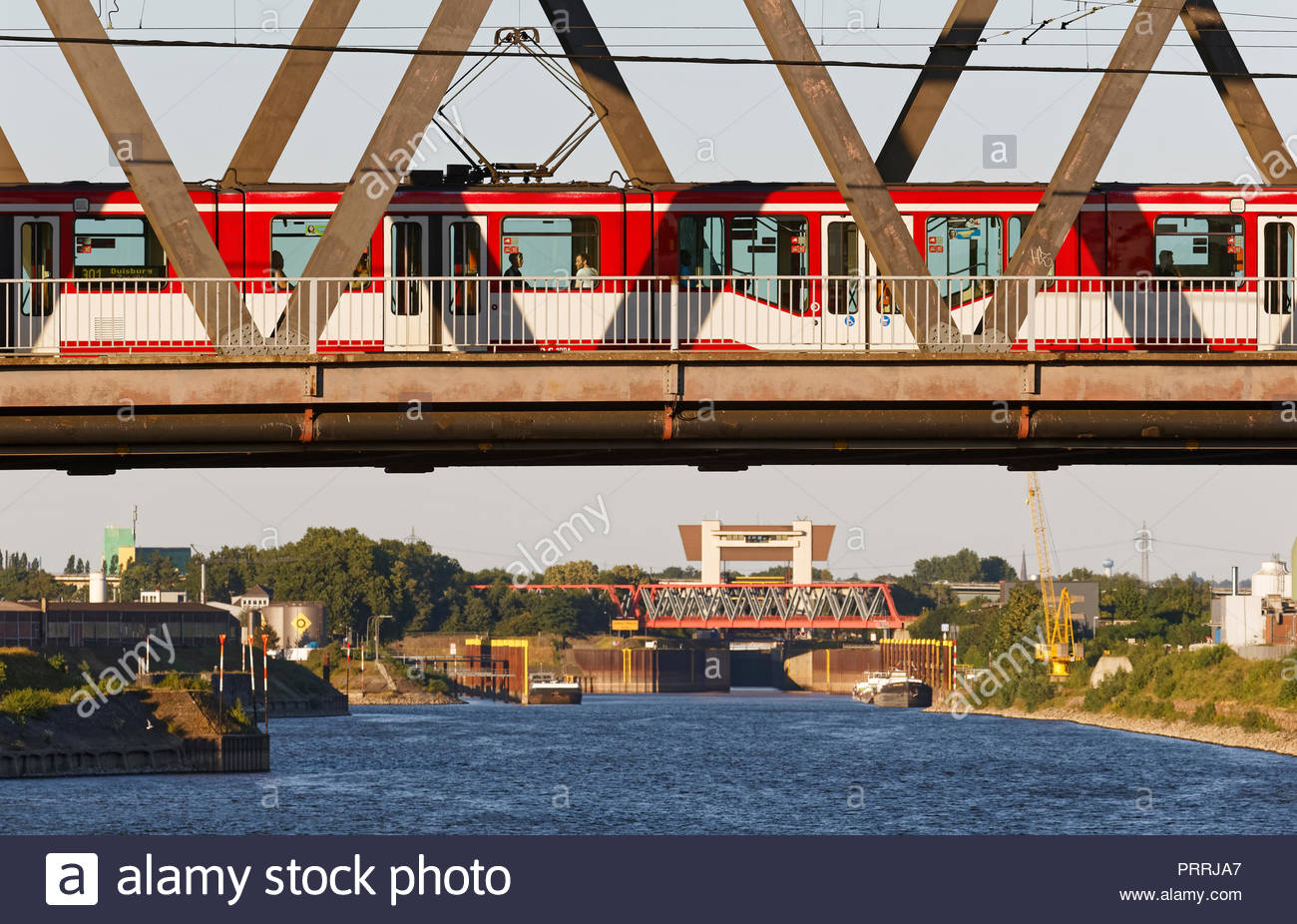 Duisburg Meiderich truss bridge with tram streetcar crossing Rhine-Herne-Canal waterway lock sluice gate tower water traffic transport inland port Stock Photo