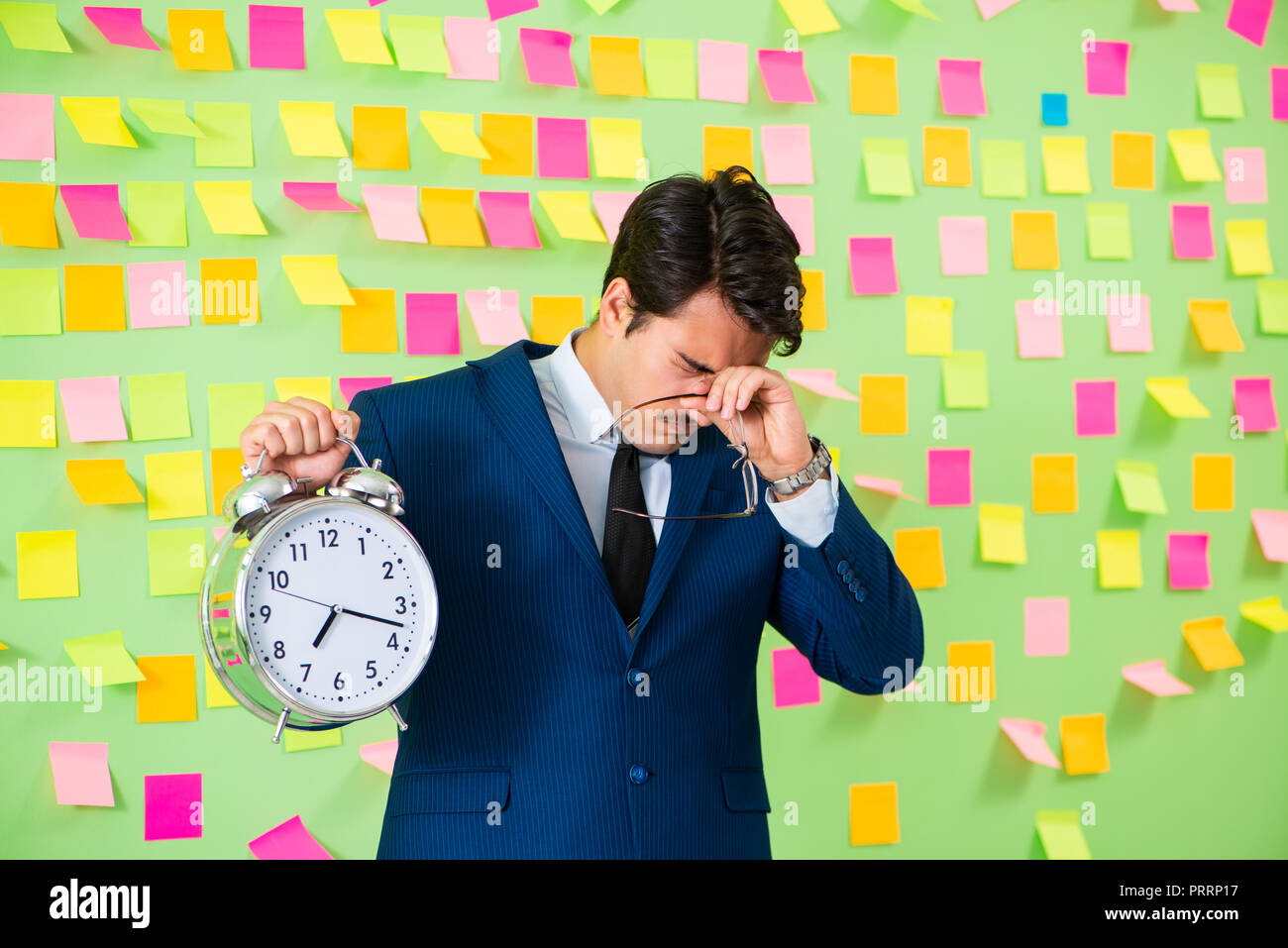 Businessman with many business priorities - Stock Image