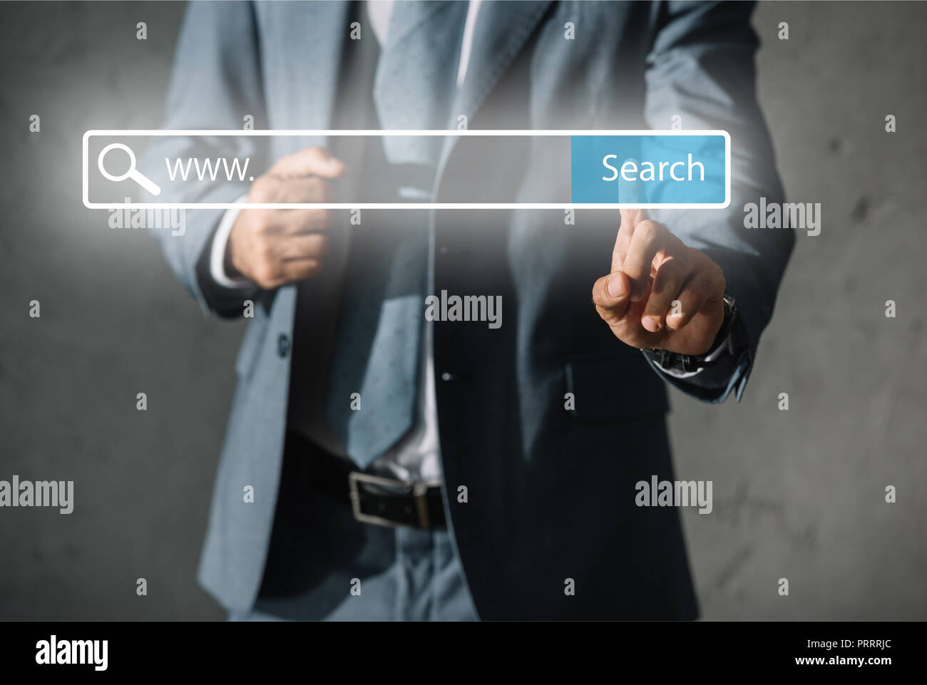 cropped view of developer in formal wear touching website search bar - Stock Image
