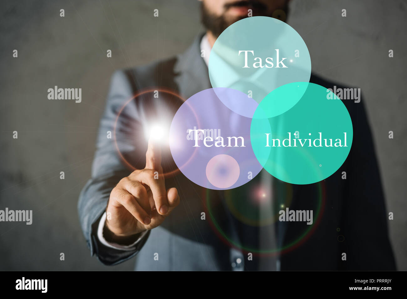 cropped view of successful businessman touching circles with task, team and individual words Stock Photo