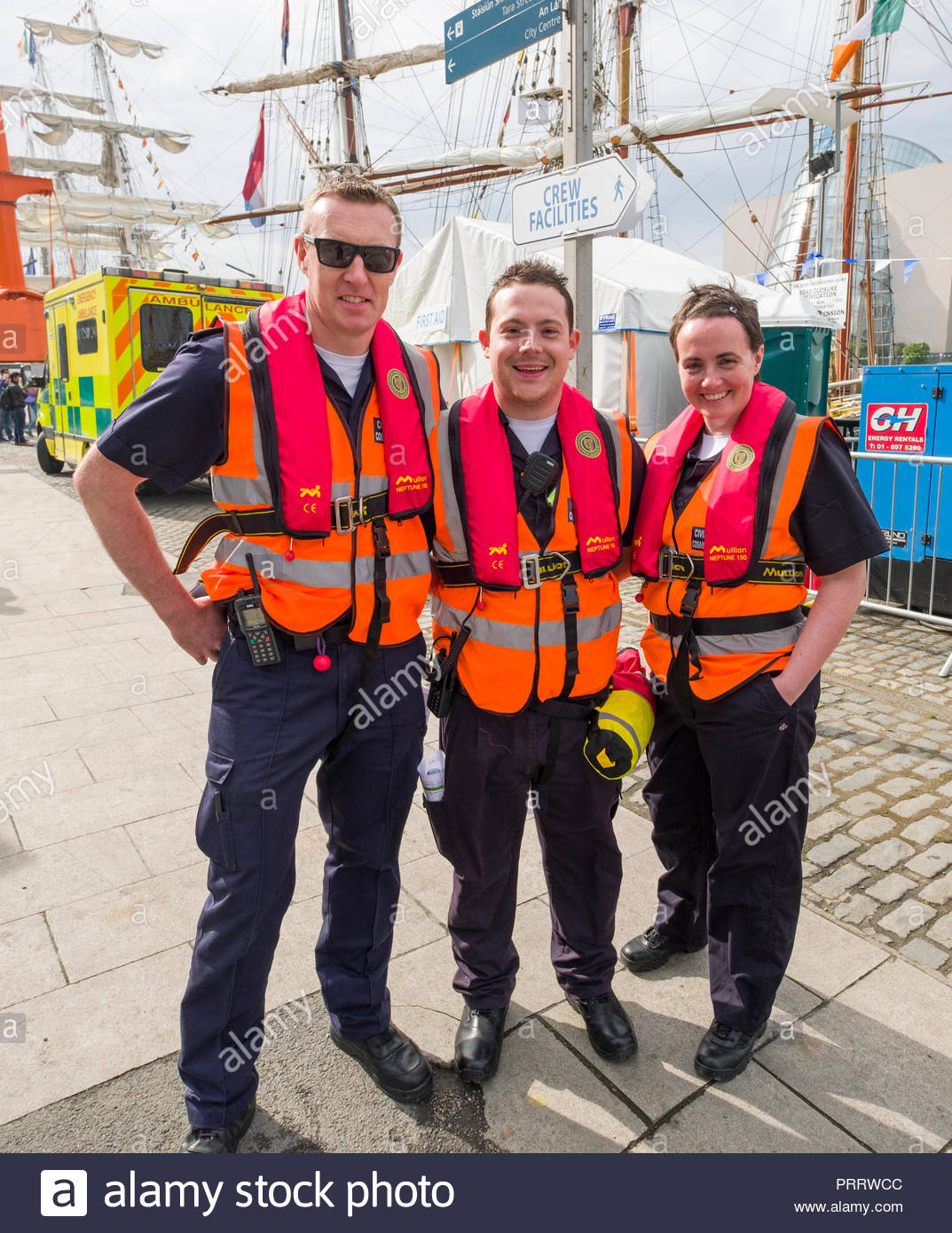 Irish Civil Defence volunteers wearing high visibility vest and inflatable personal flotation device during the 2018 Tall Ships Regatta, Sir John Roge - Stock Image