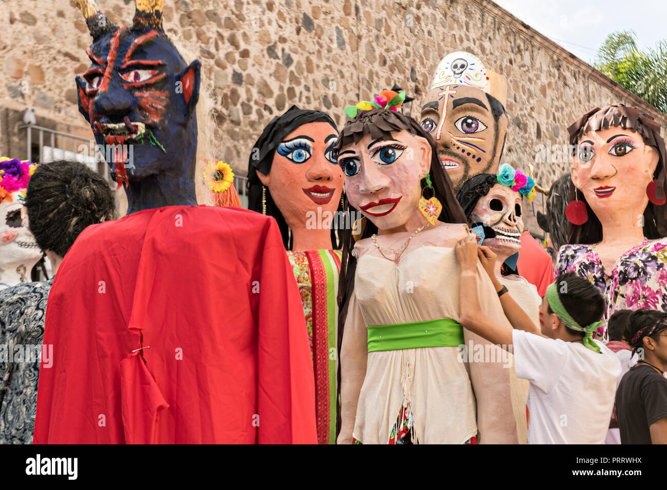 Giant paper-mache puppets called Mojigangas prepare to join in the annual parade celebrating the cities patron saint during the Feast of Saint Michael September 30, 2018 in San Miguel de Allende, Mexico. The festival is a four-day long event with processions, parades and a late night fireworks battle. - Stock Image