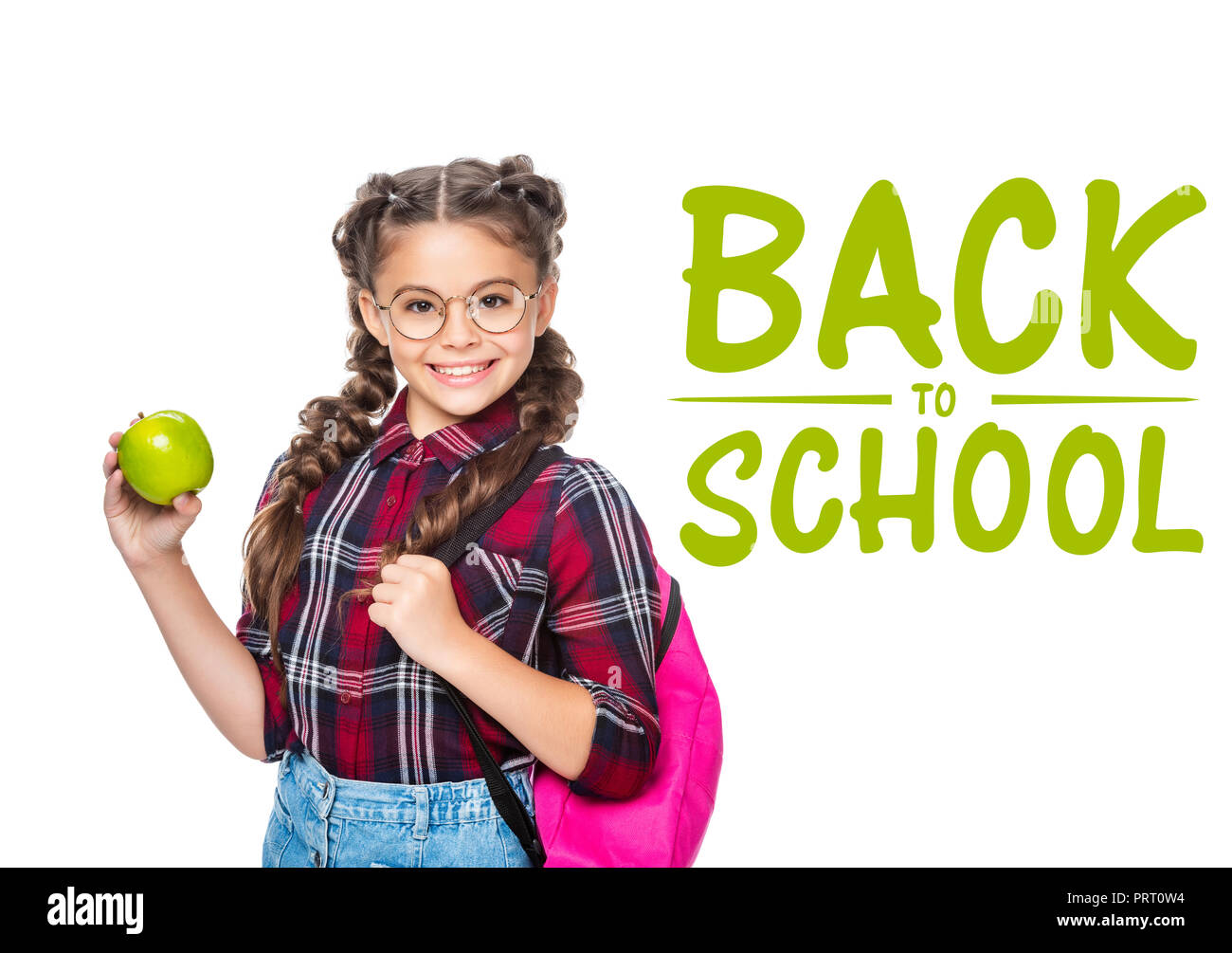fe9501375728 smiling schoolchild with backpack holding apple isolated on white ...