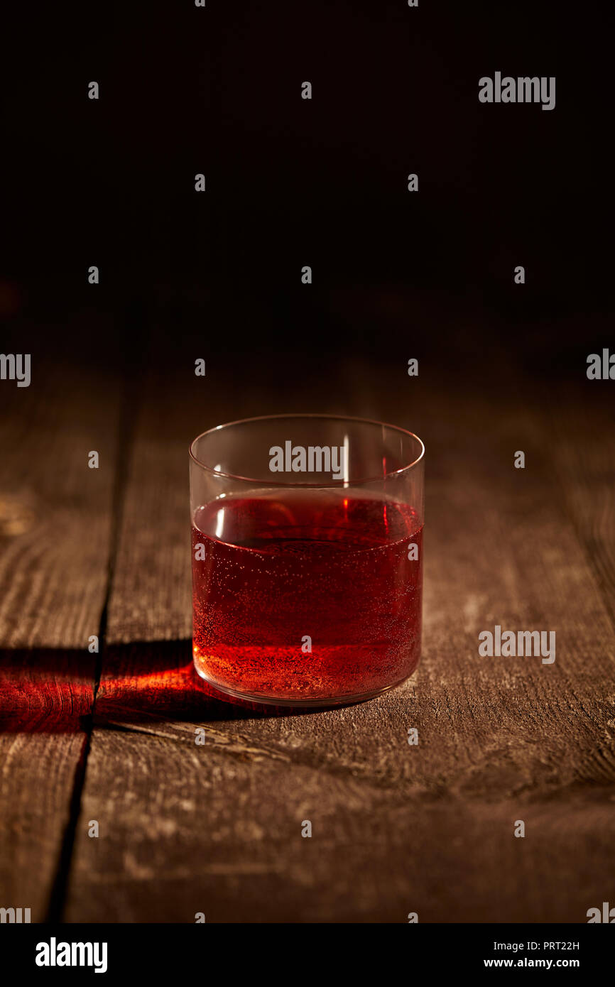 close up view of tasty mulled wine in glass on wooden surface Stock Photo