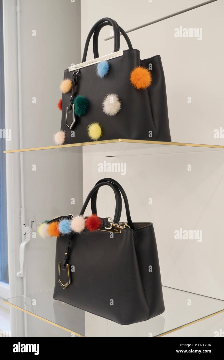62d762024c44 Fendi bags and shoes with pon pon on the shelves of a fashion store ...
