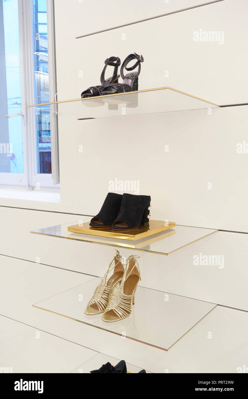 2c8582dd650d Elegant feminine shoes on the shelves of an elegant fashion store ...