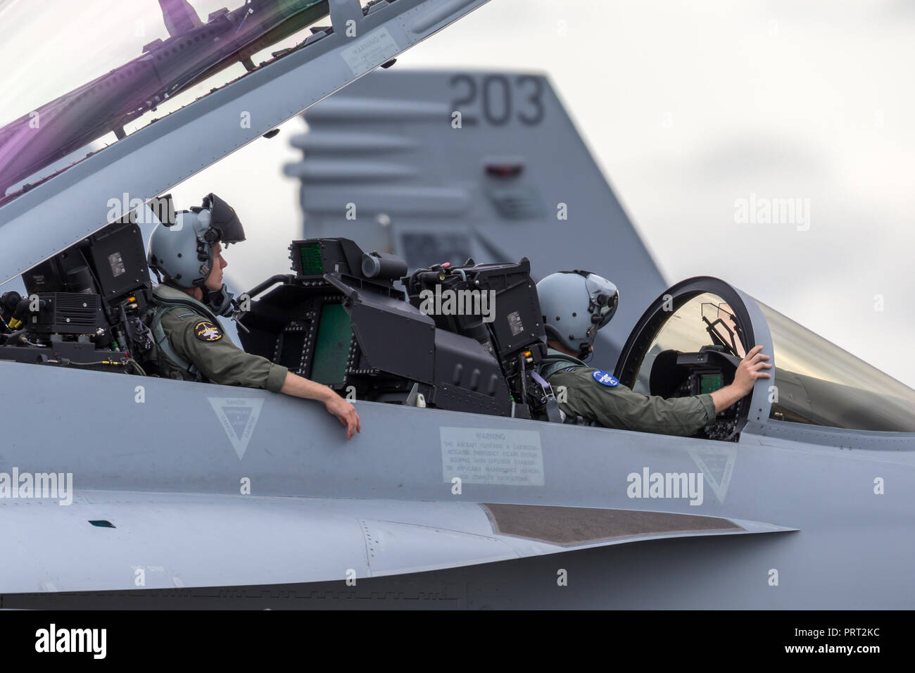 Royal Australian Air Force (RAAF) Aircrew in a Boeing F/A-18F Super Hornet multirole fighter aircraft. - Stock Image
