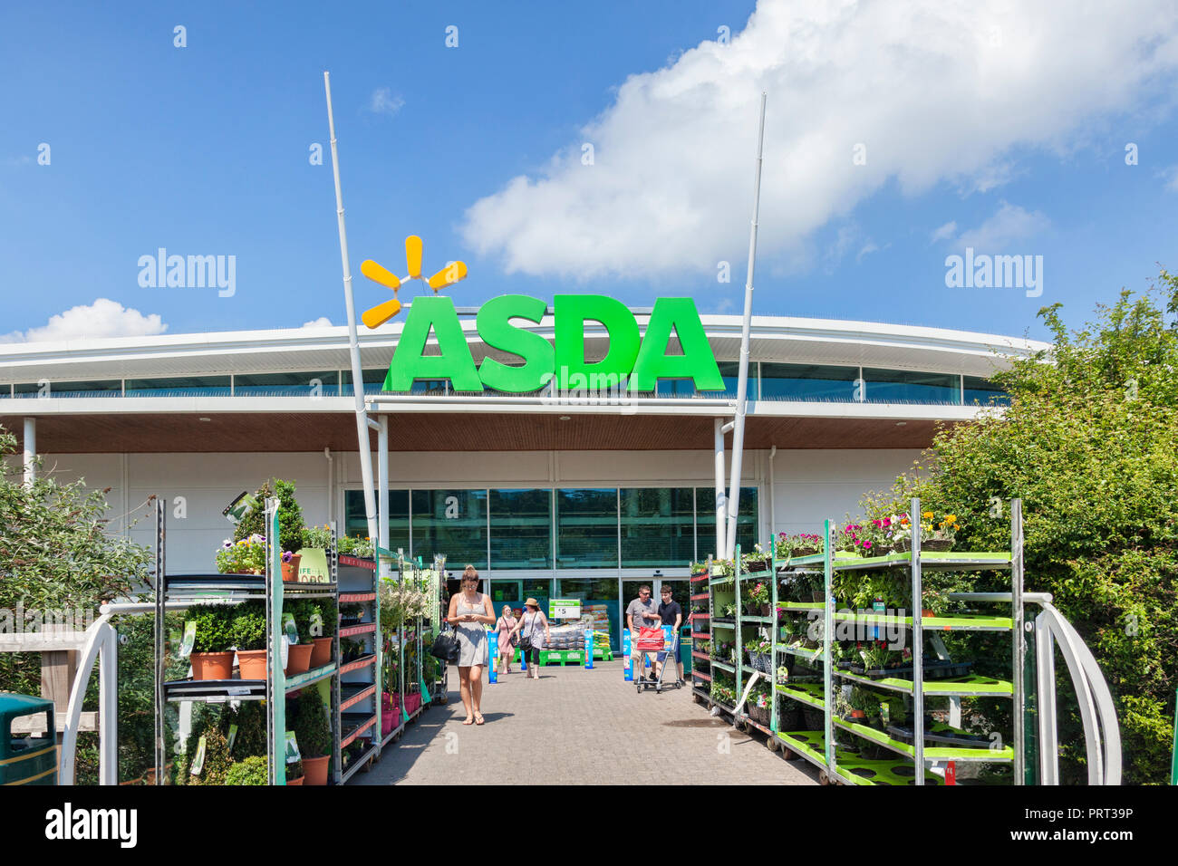 28 May 2018: Newton Abbot, Devon, UK - Asda supermarket entrance, with people leaving with their shopping. Stock Photo