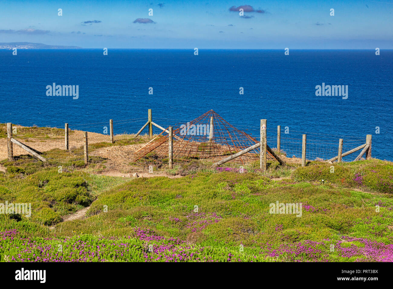 Abandoned mine shaft which has been covered over, on the North Cornish Coast near St Agnes Head, beside the south west coast path. Stock Photo
